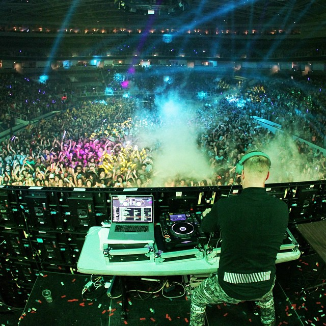 Dj on a Picnic table in an arena